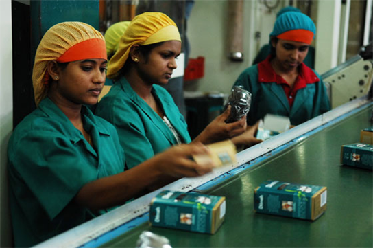 Workers at Dilmah Tea Factory